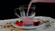 Milk is poured into a cup with raspberries video