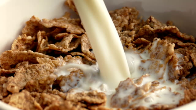 Milk Pours On Cereal Closeup video