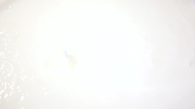 Milk rain on the white surface video
