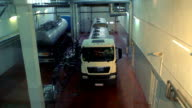 Milk truck in a dairy shop. Truck with tank at milk farm. Dairy factory. Food processing plant. Food Industry. Interior of a cheese factory. Food warehouse. Industrial equipment video
