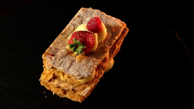 Millefeuille dessert with strawberries dessert sweet on black background cake video