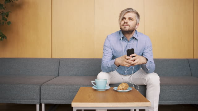Millennial listens to podcast video