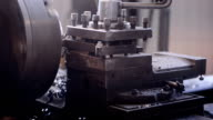 A milling machine cuts the workpiece with layers of metal shavings. Work longitudinal machine factory production video