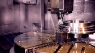CNC milling machine makes steel part on a industrial factory video