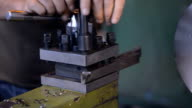 A milling machine operator prepares cutter to top jobs. fixing of the cutting head video