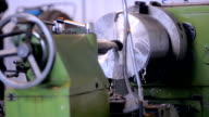A milling machine operator working factory workshop makes some particular on steel video