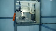 CNC milling machine produces metal detail on factory video