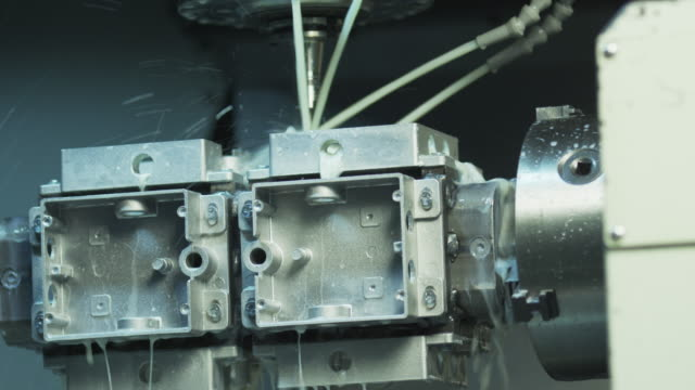 CNC Milling Machine Producing Metal Detail in Factory video