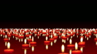 Millions of candles burning at the wind, copy space video