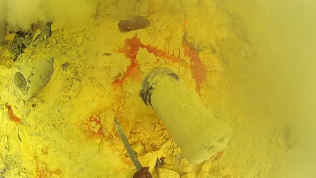 Miner Extracting Sulfur at Kawah Ijen Volcano, East Java, Indonesia - POV video