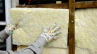 mineral rock wool insulation on wooden wall video