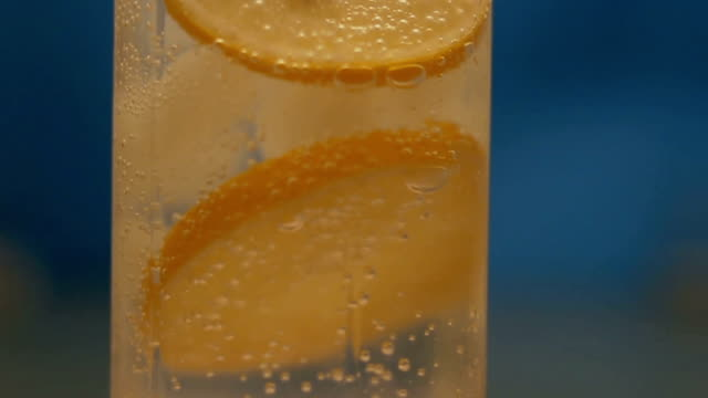 Mineral water with ice and lemon video