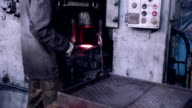 Mining and metal forging factory. Worker operates with automated Metalworking machine video