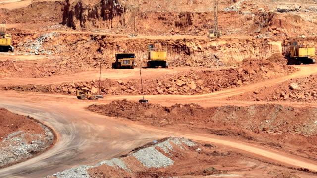Mining dump trucks and excavators video