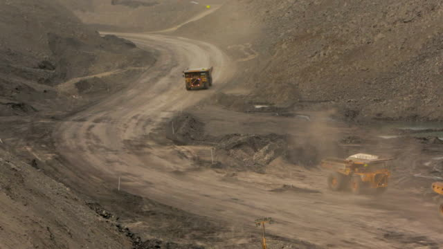 Mining trucks at a coal mine video