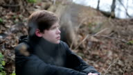 Miserable teenager alone behind barb wire, lonely foster child looking video