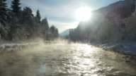AERIAL: Mist above the snowy river in winter morning video