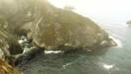 Mist over coastal landscape - HD video