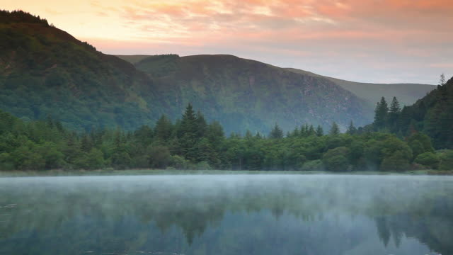 misty lake at dawn video