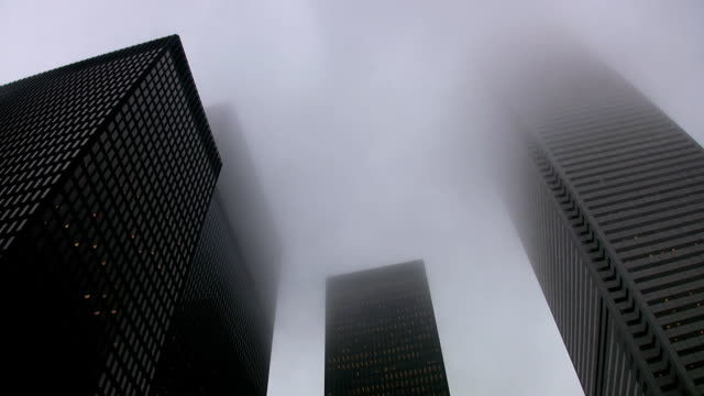 Misty skyscrapers. Timelapse effect applied. video