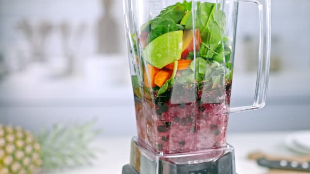 SLO MO Mix of vegetables and fruit whirling in blender video