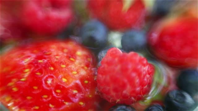 Mixed berries in water video