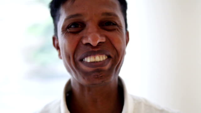 Mixed Race Adult smiling in camera video