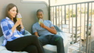 Mixed Race Couple Enjoying a Sunset Drink in Los Angeles video