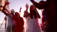 mixed race Group of friends dancing at sunset yacht party video