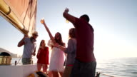 mixed race Group of friends enjoying a sunset yacht party video