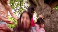 mixed race group of little girls smiling together in park video
