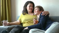 DOLLY: Mixed race lesbian couple at home video