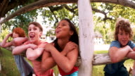 mixed race person of laughing children in a summer park video