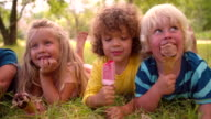 Mixed racial group of child friends eating ice creams video