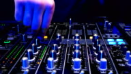 mixer control panel at a concert, hands, worker soundman moving faders control the console video