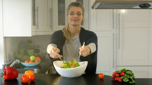 Mixing a Salad with a Smile video