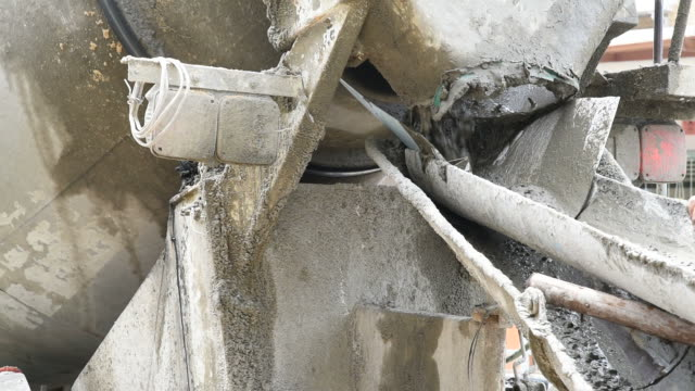 Mixing cement concrete at construction site video