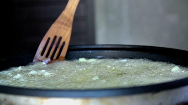 Mixing frying potatoe in hot oil video