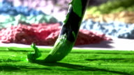 Mixing green paint. video