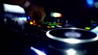 DJ mixing music at club closeup. video