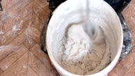 Mixing putty mixture for construction video