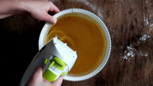 Mixing scrambling yolks Eggs video