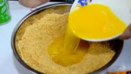 mixing  yolk and cracker for doing dessert video