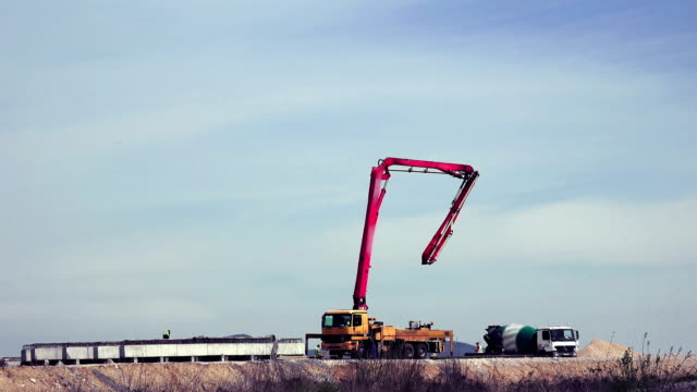 mobile crane lifting generator on road construction site, contracting hand jib timelapse video