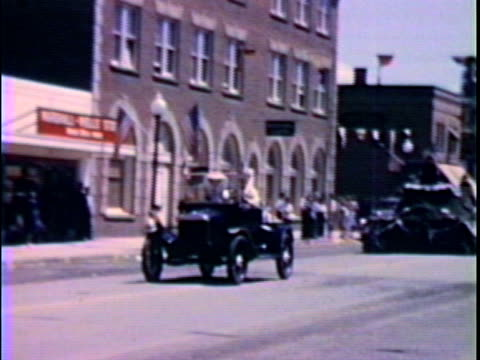 Model A car in parade--From 1950's film video