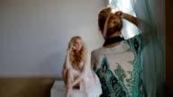 Model pose to photographer in studio video