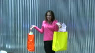 (HD1080i) Model Poses with Shopping Bags under Sun Shade video