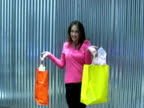 Model Poses with Shopping Bags under Sun Shade video