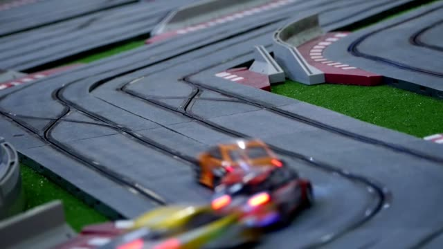 Model race cars on the racing track video