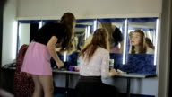 Models are busy with preparation for photo session in dressing room video